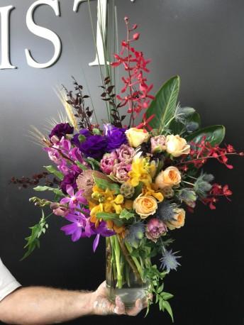 Tasteful Florals Arrangement In A Glass Vase